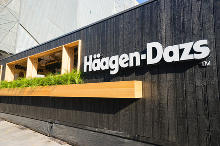 temporarily: Melbourne, Australia - March 11, 2016: View of the Haagen-Dazs cafe at Federation Square in Melbourne. The cafe is temporarily built to serve 12 signature ice-cream flavours to customers.