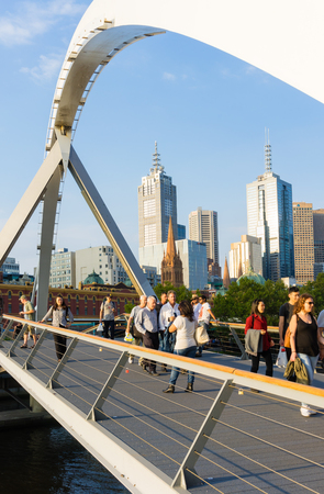 southgate: Melbourne, Australia - March 11, 2016: View of people walking across the Southgate footbridge in Melbourne during daytime