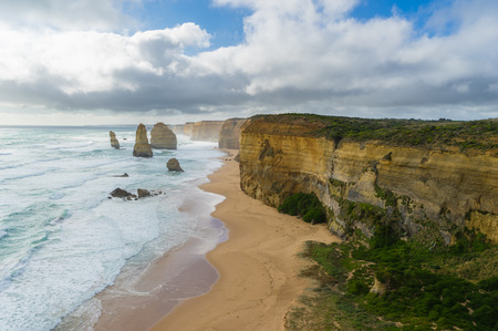 View of Twelve Apostles, waves and the beach in Great Ocean Road in Victoria, Australia during daytime Stock Photo