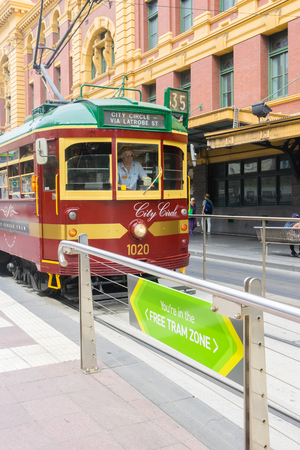 Melbourne, Australia - March 5, 2016: Vintage tram, City Circle stops at the Free tram zone in a tram station in downtown Melbourne, Australia. Travel on trams within this zone is free.