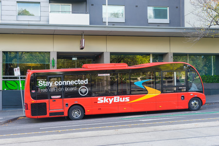 Melbourne, Australia - May 1, 2016: SkyBus waiting for departure outside a hotel in Melbourne. SkyBus has provided  transfer service from Melbourne Airport to the city centre for over 35 years. Editorial