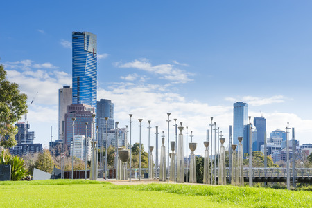 pubic: Melbourne, Australia - August 15, 2015: View of Birrarung Marr Park featuring the Federation Bells, an installation art on Yarra Rivers north bank with cityscape in the background in Melbourne.