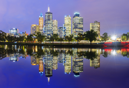 city centre: Melbourne, Australia - November 10, 2015: Melbourne skyline panorama across the Yarra river with reflection at sunset. Melbourne is the most liveable city in the world.