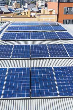 Close-up of rooftop solar panels of a building in Sydney, Australia during daytime
