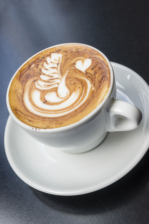 Swan cappuccino art coffee on black, wooden table in a cafe Stock Photo - 61934439