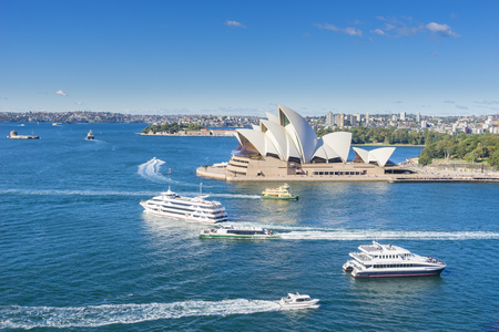 Sydney, Australia - June 22, 2016: Aerial view of Sydney Opera House with ferries and cruises in the harbour during the daytime. The Opera House is one of the most iconic buildings in Australia. Editorial