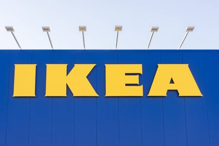 ikea: Canberra, Australia - June 29, 2016: View of IKEA sign on a wall against a clear sky background. IKEA is the worlds largest furniture retailer. Editorial