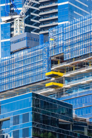 Close-up of modern, glass building under construction during daytime Stock Photo - 62119662