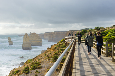 Victoria, Australia - November 23, 2015: View of tourists walking on the viewing platform of Twelve Apostles in Great Ocean Road in Victoria, Australia during daytime.