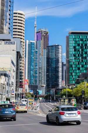 Melbourne, Australia - March 17, 2016: View of busy traffic on the street with modern residential and office buildings in  Melbourne during daytime.