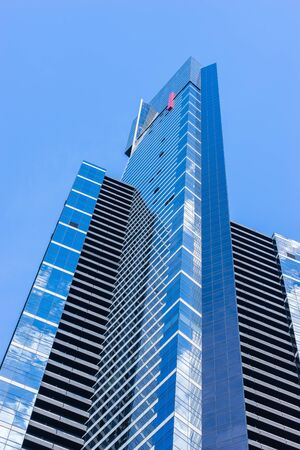 Melbourne, Australia - March 17, 2016: Close-up of Eureka Tower, the tallest building in Melbourne, in blue sky. It is residential building but there is a public observation deck on 88th floor. Editorial