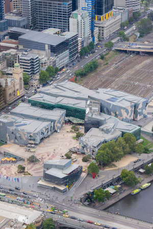 Melbourne, Australia - March 17, 2016: Aerial view of Federation Square and Melbourne cityscape. Federation Square hosts many cultural events and is one of the most iconic places in Melbourne. Editorial