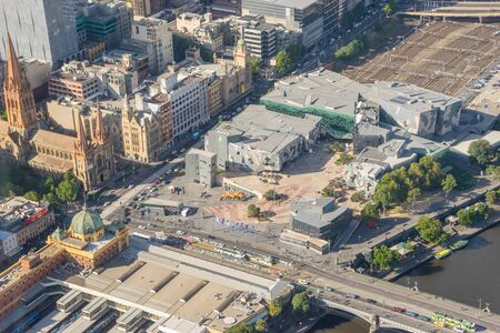 Melbourne, Australia - March 17, 2016: Aerial view of Federation Square and Melbourne cityscape during daytime. Federation Square hosts lots of cultural events and is an iconic place in Melbourne. Editorial