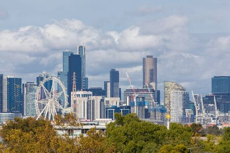 Melbourne, Australia - April 11, 2016: View of downtown Melbourne with modern buildings, Melbourne Star Observation Wheel and buildings under construction during daytime. Editorial