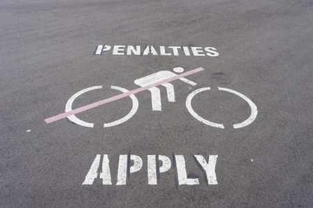 Penalties apply and no cycling wordings and graphics on the road Stock Photo - 62496354