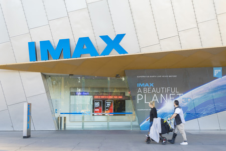 Melbourne, Australia - July 9, 2016: View of people in front of the IMAX theatre during daytime. IMAX Melbourne has the second largest screen in the world.