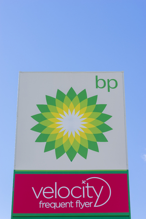 Sydney, Australia - June 28, 2016: Close-up of bp, petrol station sign against the blue sky. BP service station has launched the velocity frequent flyer programme for customers to earn points.