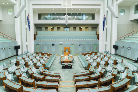 Canberra, Australia - June 28, 2016: View of inside of the House of Representatives chamber of the Parliament House where federal laws are debated and voted by members.
