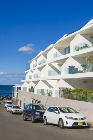 Sydney, Australia - June 25, 2016: View of modern apartments across the road at Bondi Beach during daytime. Bondi Beach is one of the most famous beaches in Australia. Stock Photo - 60879975