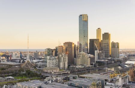 Melbourne, Australia - July 31, 2016: Aerial view of Melbourne cityscape with modern buildings during sunset. Melbourne is one of the most populous city in Australia.
