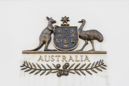 Canberra, Australia - June 28, 2016: View of The Commonwealth Coat of Arms, the formal symbol of the Commonwealth of Australia, in bronze outside the old Parliament House. Stock Photo - 61277521