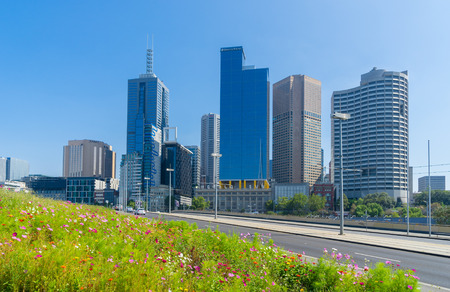 Melbourne, Australia - February 12, 2016: Modern buildings and flowers garden in Melbourne during daytime.