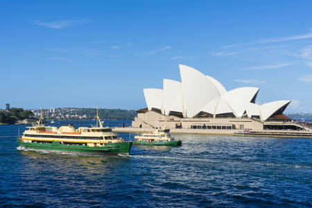 Two ferries in front of Sydney Opera House, Australia