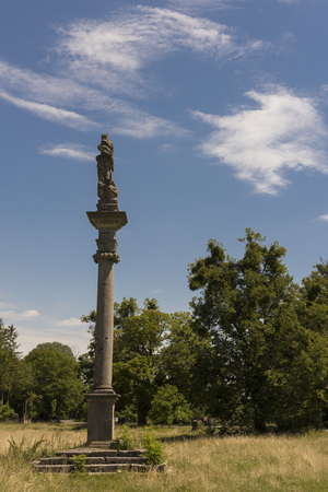 ble: Antique column with statue up the top