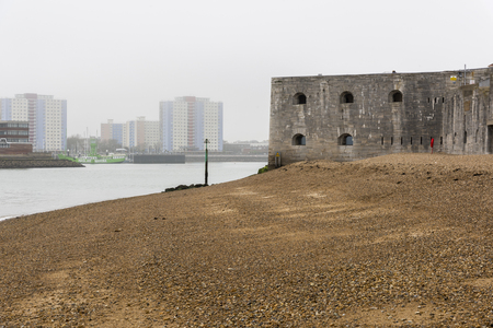 View along the Solent of the historic defensive walls, known as the Battery, with the Square Tower. Portsmouth, Hampshire