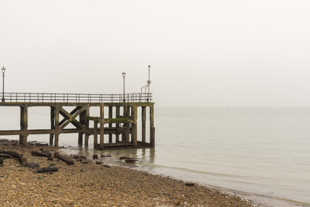 Old pier with sea in background