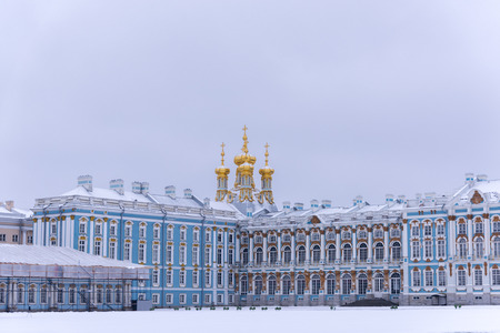Fragment of the facade of the Catherine Palace with the domes of the Resurrection Church on a dull Janyary day. Pushkin, Tsarskoye Selo, St. Petersburg