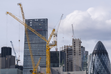 Construstion cranes in front of a building site in the City of London