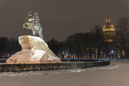 Night view of Bronze Horseman with Isaakievskiy Cathedral in St Petersburg Russia