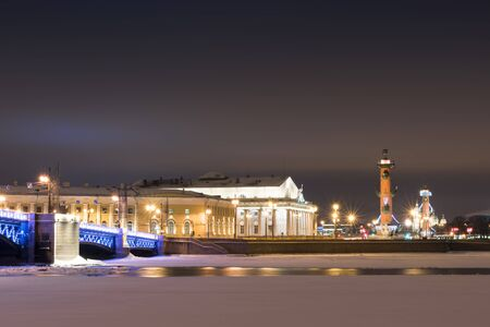 Night view of Old Saint Petersburg Stock Exchange and Rostral Columns Editorial