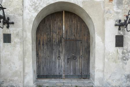 Ancient wooden gate with door knockers