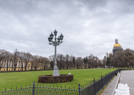 Old Vintage Street Lamp Post with a view of Isaakievskiy Cathedral in the background, St Petersburg, Russia
