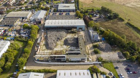 Aerial view of a warehouse destroyed by fire and filled with waste, Margate, Kent, UK