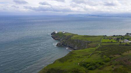 Beautiful view of Valentia Island Lighthouse at Cromwell Point. Scenic Irish countyside on sunny summer day, County Kerry, Ireland. Zdjęcie Seryjne