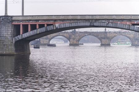 Skyline view with historic Charles Bridge or Karluv Most and Vltava river, Prague, Czech Republic 스톡 콘텐츠