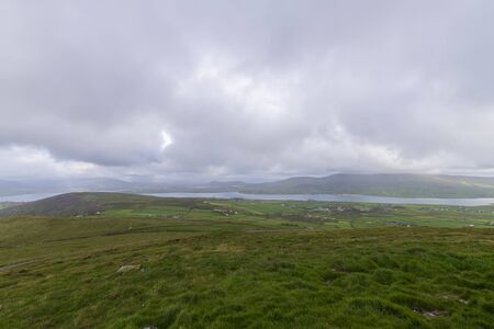 Beautiful aerial view of Beginish Island. Locations worth visiting on the Wild Atlantic Way. Scenic Irish countyside on sunny summer day, County Kerry, Ireland.