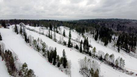 Aerial view of downhill skiing at local ski resort. Ski lift. Russia, Leningrdaskaya oblast, village Korobitsyno near Saint Petersburg. Stok Fotoğraf