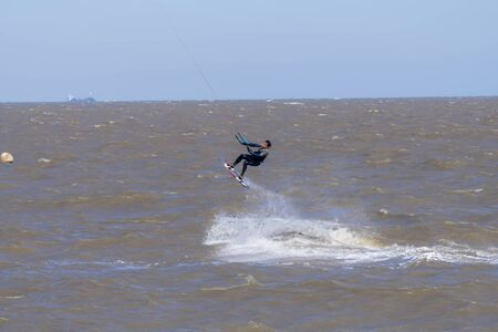 A kite surfer working the wind and surf of the English Channel off the Kent coast, Whitstable