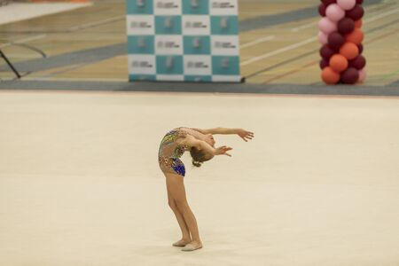 Portrait of a young gymnast. Portrait of a 7 years old girl in rhythmic gymnastics competitions