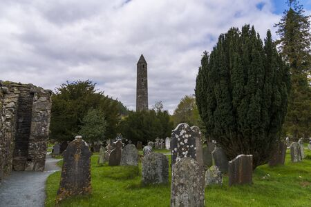 Monastic cemetery of Glendalough, Ireland. Famous ancient monastery in the wicklow mountains with a beautiful graveyard from the 11th century