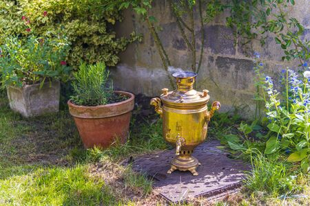 Old vintage samovar with smoke. Brewing tea in the old fashioned way. Russian ceremony