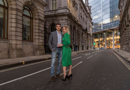 Young flirty couple posing on a street of City in London, UK