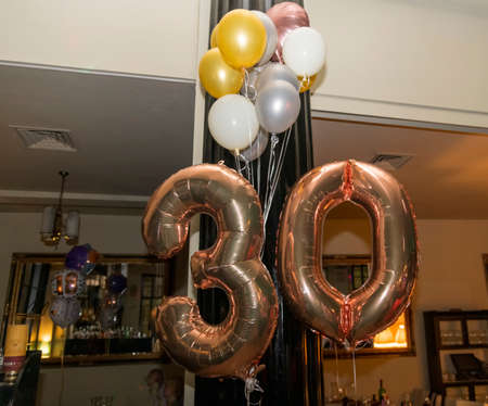 Golden number 30 thirty made of inflatable balloons