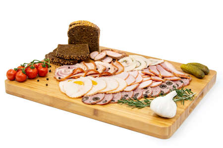 Various meat cold cut platter on a wooden board 스톡 콘텐츠