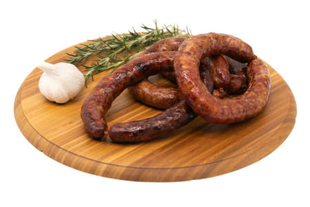 Coiled cumberland sausage with garlic rustic board