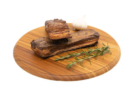 Delicious artisanal whole smoked slab bacon on a cutting block.